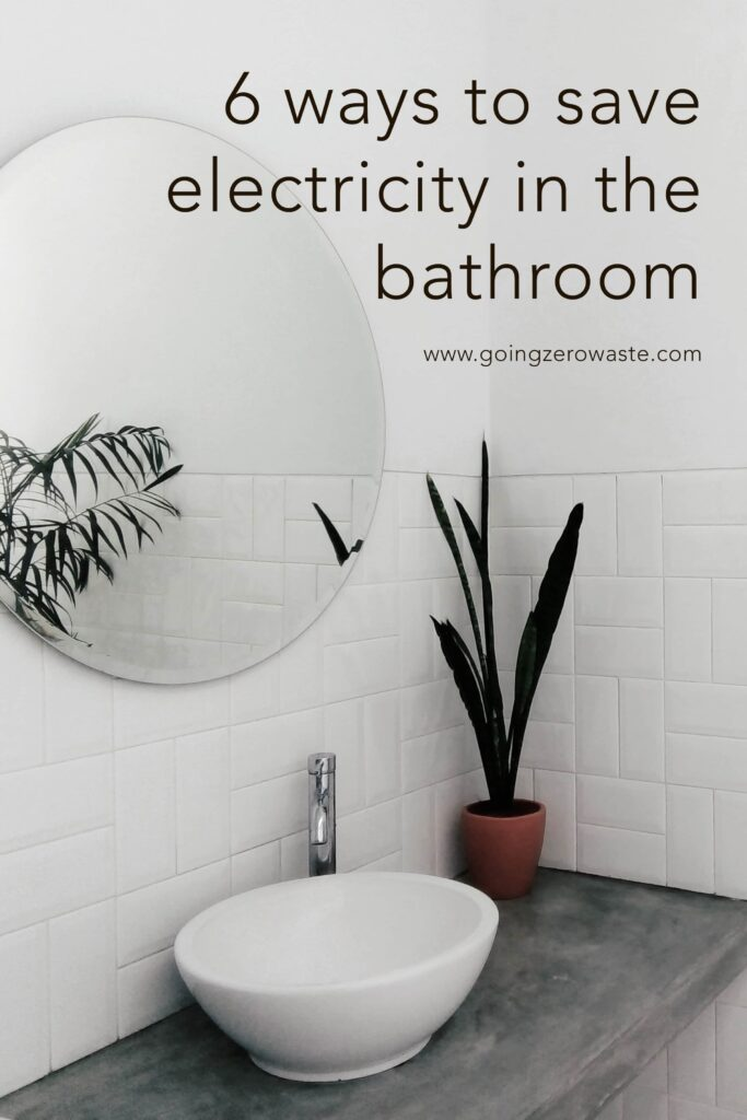 Picture of a bathroom with the text 6 Ways to Save Money on Your Electric Bill in the Bathroom