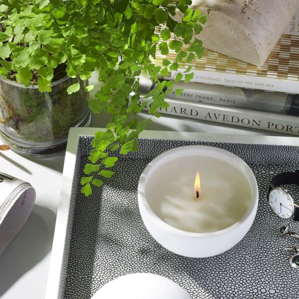 phlur eco-friendly, zero waste, non-toxic candles in pretty jars